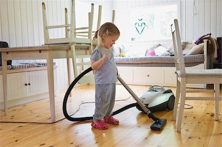 Young Girl Vacuuming Hardwood Floor, Sweden Stock Photo - Premium Royalty-Free, Code: 600-04926392