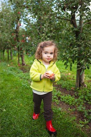 single fruits tree - Girl at Apple Farm, Hood River County, Oregon, USA Stock Photo - Premium Royalty-Free, Code: 600-04931769