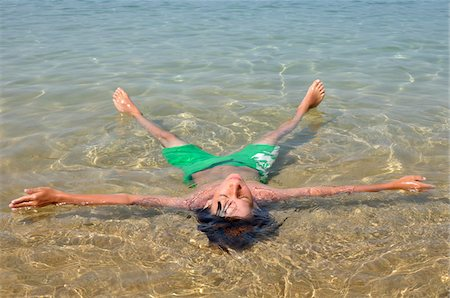 Boy Floating in Water, Corsica, France Stock Photo - Premium Royalty-Free, Code: 600-05181840