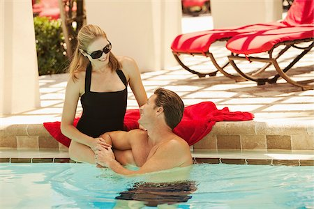 Couple at Pool, Palm Beach Gardens, Florida, USA Stock Photo - Premium Royalty-Free, Code: 600-05181864