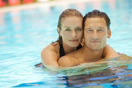 Portrait of Couple in Pool, Palm Beach Gardens, Florida, USA Stock Photo - Premium Royalty-Free, Code: 600-05181865