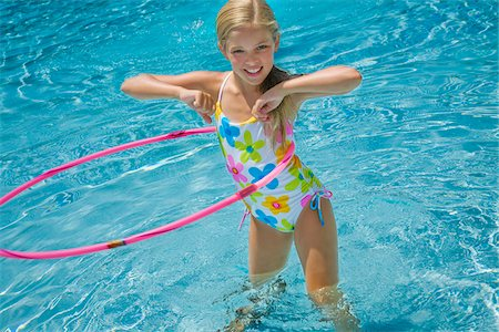 Girl in Pool with Hula Hoop Stock Photo - Premium Royalty-Free, Code: 600-05181875