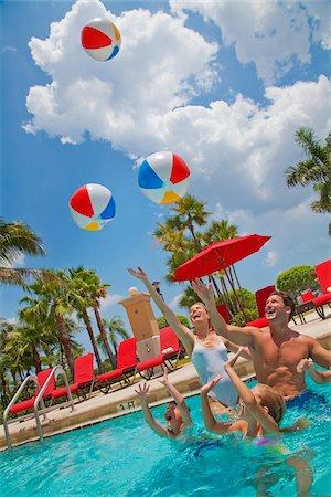 Family in Pool, PGA National Resort and Spa, Palm Beach Gardens, Florida, USA Stock Photo - Premium Royalty-Free, Code: 600-05181871
