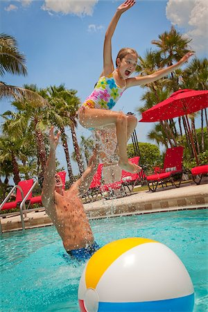 Father Tossing Daughter into Pool, PGA National Resort and Spa, Palm Beach Gardens, Florida, USA Stock Photo - Premium Royalty-Free, Code: 600-05181872