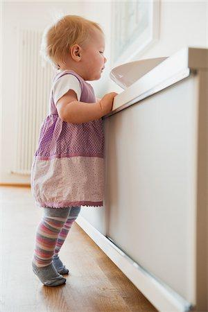 Baby Girl looking in Bowl Stock Photo - Premium Royalty-Free, Code: 600-05181884