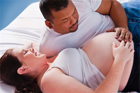 Man Touching Pregnant Woman's Stomach Stock Photo - Premium Royalty-Free, Code: 600-05389279