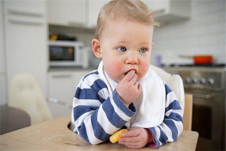 Portrait of Baby Girl Eating, London, England Stock Photo - Premium Royalty-Free, Code: 600-05451161