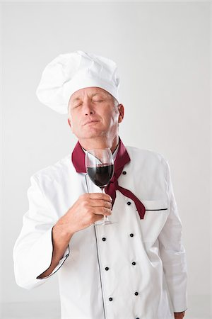 smelling - Chef Smelling Red Wine Stock Photo - Premium Royalty-Free, Code: 600-05452089