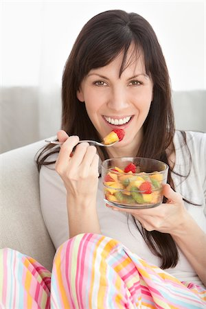 Close-up of Woman Eating Bowl of Fruit Stock Photo - Premium Royalty-Free, Code: 600-05452204
