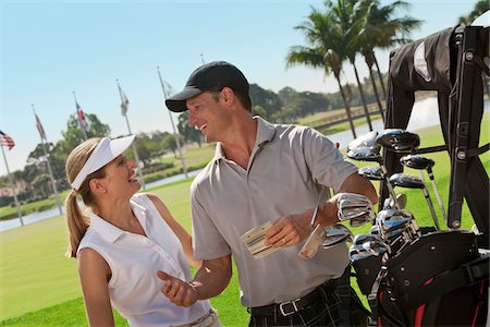 Close-up of Couple Golfing Stock Photo - Premium Royalty-Free, Code: 600-05524088