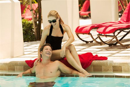 Couple at Swimming Pool Stock Photo - Premium Royalty-Free, Code: 600-05524089