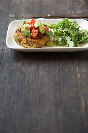 fork - Lentil Patty with Avocado, Tomato, and Arugula Stock Photo - Premium Royalty-Free, Code: 600-05524116