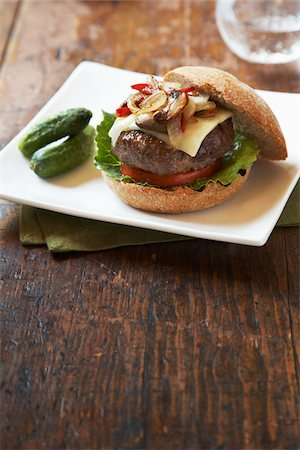 Burger With Mushrooms, Cheese, Peppers and Onions on Whole Wheat Bun Stock Photo - Premium Royalty-Free, Code: 600-05524113