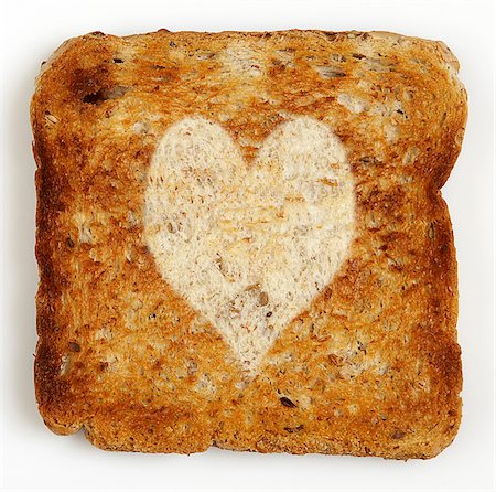 stamped - Slice of Toast with Heart Shape Stock Photo - Premium Royalty-Free, Code: 600-05524173