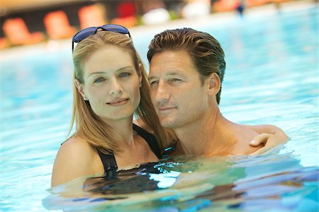 Portrait of Couple in Swimming Pool Stock Photo - Premium Royalty-Free, Code: 600-05524472