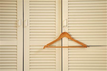 Wooden Hanger on Closet Door, Alpes, France Stock Photo - Premium Royalty-Free, Code: 600-05524678