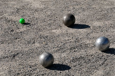 Bocce Balls on Ground, Alps, France Stock Photo - Premium Royalty-Free, Code: 600-05524673