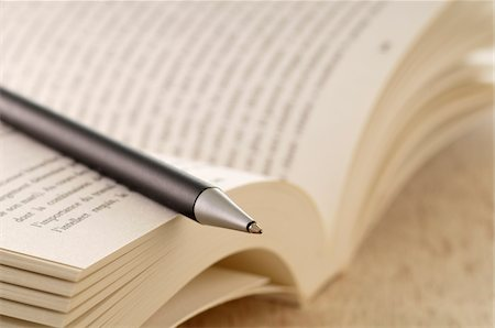 Close-up of Open Book and Pen Stock Photo - Premium Royalty-Free, Code: 600-05524686