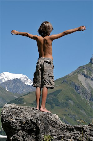 rear - Back View of Boy Standing on Boulder, Alps, France Stock Photo - Premium Royalty-Free, Code: 600-05524683