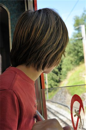 preteen long hair - Back View of Boy on Train, Alps, France Stock Photo - Premium Royalty-Free, Code: 600-05524691