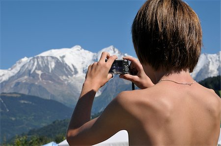 Back View of Boy taking Picture of Mountains, Alps, France Stock Photo - Premium Royalty-Free, Code: 600-05524692