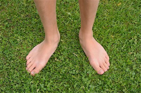 Close-up of Boy's Bare Feet on Grass, Alps, France Stock Photo - Premium Royalty-Free, Code: 600-05524693