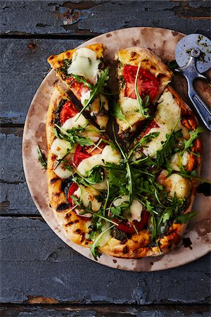 Homemade Pizza Stock Photo - Premium Royalty-Free, Code: 600-05560185