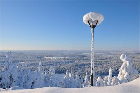 Snow Covered Street Light overlooking Forest, Rukatunturi, Kuusamo, Northern Ostrobothnia, Finland Stock Photo - Premium Royalty-Free, Code: 600-05610036