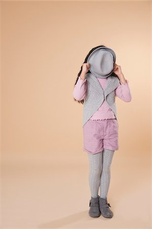 preteen girls faces photo - Girl Covering Face with Hat Stock Photo - Premium Royalty-Free, Code: 600-05653058