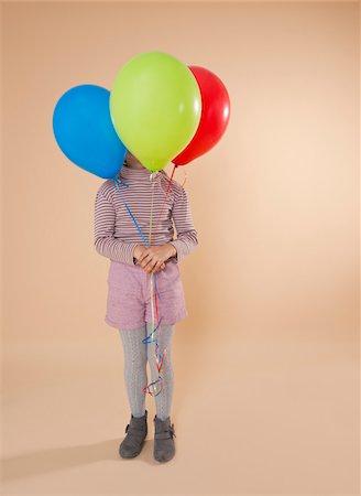 Girl Holding Balloons Stock Photo - Premium Royalty-Free, Code: 600-05653065