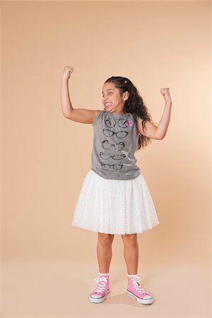 Portrait of Girl Flexing Arms Stock Photo - Premium Royalty-Free, Code: 600-05653068