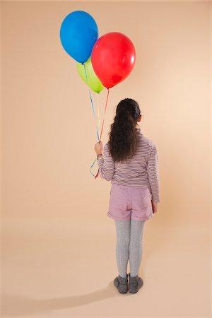 Girl Holding Balloons Stock Photo - Premium Royalty-Free, Code: 600-05653063