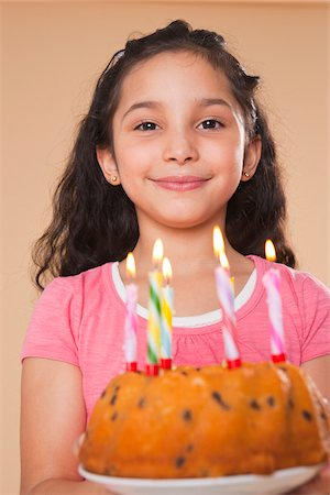 preteen  smile  one  alone - Portrait of Girl Holding Birthday Cake Stock Photo - Premium Royalty-Free, Code: 600-05653076