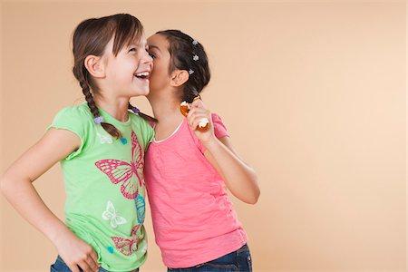 Portrait of Girls Whispering Stock Photo - Premium Royalty-Free, Code: 600-05653070