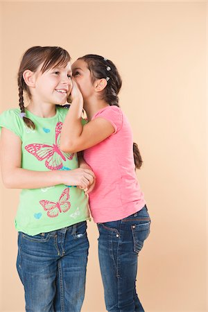 preteen girl pigtails - Portrait of Girls Whispering Stock Photo - Premium Royalty-Free, Code: 600-05653072