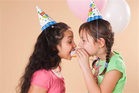 Portrait of Girls Eating Doughnut Stock Photo - Premium Royalty-Free, Code: 600-05653080