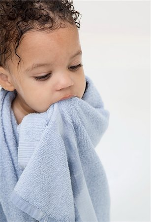 Boy Wrapped in Towel after Bath Stock Photo - Premium Royalty-Free, Code: 600-05653226