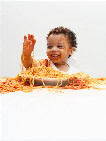 stains and discolorations - Boy eating Spaghetti with Hands Stock Photo - Premium Royalty-Free, Code: 600-05653252