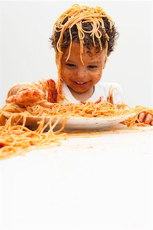 stains and discolorations - Boy eating Spaghetti with Hands Stock Photo - Premium Royalty-Free, Code: 600-05653253