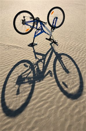 Bicycle Turned Upside Down on Beach Stock Photo - Premium Royalty-Free, Code: 600-05662613