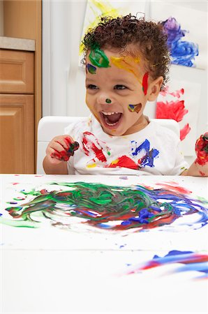 Little Boy Finger Painting Stock Photo - Premium Royalty-Free, Code: 600-05786119