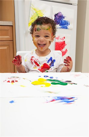 Little Boy Finger Painting Stock Photo - Premium Royalty-Free, Code: 600-05786124