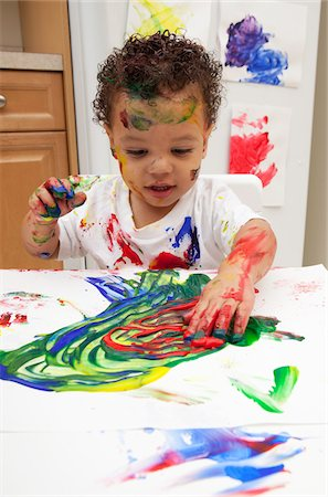 stains and discolorations - Little Boy Finger Painting Stock Photo - Premium Royalty-Free, Code: 600-05786121