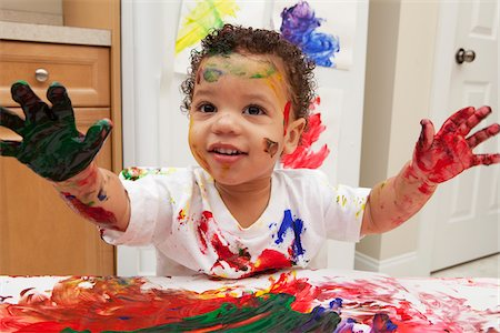 Little Boy Finger Painting Stock Photo - Premium Royalty-Free, Code: 600-05786122