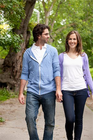 Young Couple Walking through Park Stock Photo - Premium Royalty-Free, Code: 600-05786149