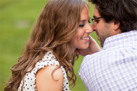 Close-up of Young Couple Kissing in Park Stock Photo - Premium Royalty-Free, Code: 600-05786176