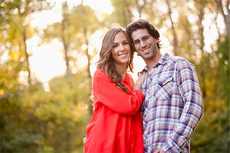 Portrait of Young Couple in Park Stock Photo - Premium Royalty-Free, Code: 600-05786179