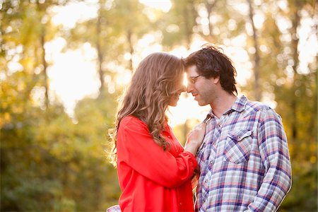 Young Couple Embracing in Park Stock Photo - Premium Royalty-Free, Code: 600-05786180