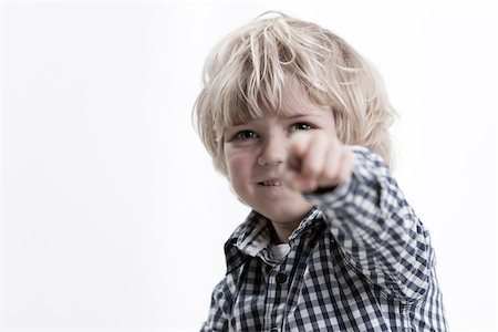 focus on background - Portrait of Boy Pointing Stock Photo - Premium Royalty-Free, Code: 600-05786328
