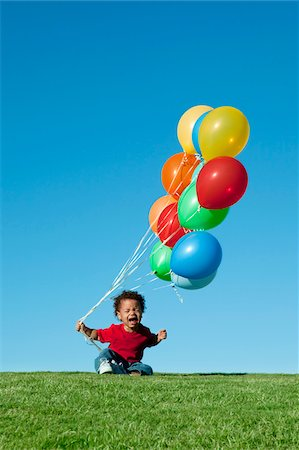 Crying Boy with Balloons Stock Photo - Premium Royalty-Free, Code: 600-05786569